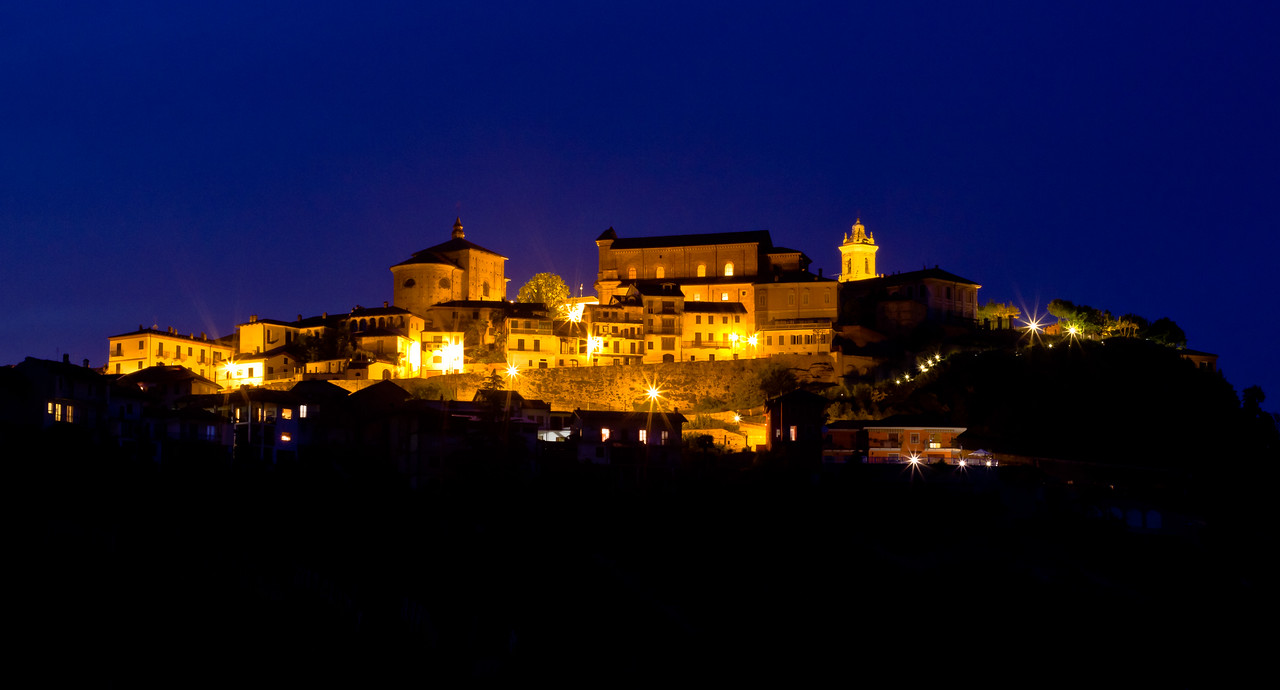 A long exposure captures the medieval village of La Morra, in the heart of the Barolo winegrowing area, as the last few moments of daylight disappear for the night.