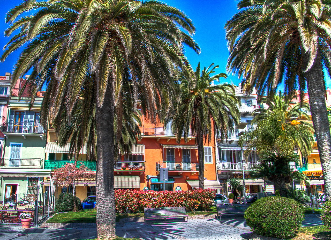 This handheld image is meant to capture the wonderful colorful town of Loano, on the Ligurian coast of Italy. Otherwise known as the Italian Riviera, this town reminded me of Disneyworld meets the Riveria - each building so colorful and appealing as to seem unreal, as if it could be found on a movie studio set. But it's all real, and it's all quite pleasing. This winegrowing area is best known for the Vermentino varietal, which pairs well with the light, seafood inspired cuisine the area is well known for. This handheld image was taken on the boardwalk/street that separates various stores and apartments with the Ligurian Sea, just a mere 50 feet behind me as I took this photo.