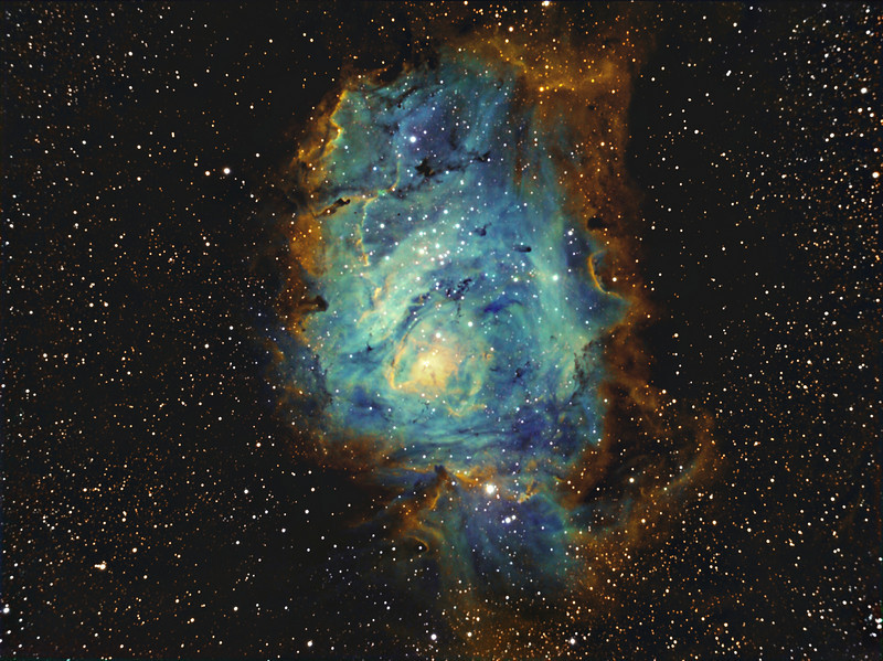 "I'm experimenting on fine tuning my processing workflow, and this is a reprocessing of M8 captured between 15-18th May 2009, processing incorporates Tone Mapping method. Previous attempt can be seen here: <a href=""http://ejcruz.smugmug.com/Photography/Nebulas/Astrophotography-Narrowband/M814h20mSii-Ha-OiiiLumCrop/556957815_3UbGV-M.jpg"">http://ejcruz.smugmug.com/Photography/Nebulas/Astrophotography-Narrowband/M814h20mSii-Ha-OiiiLumCrop/556957815_3UbGV-M.jpg</a>"