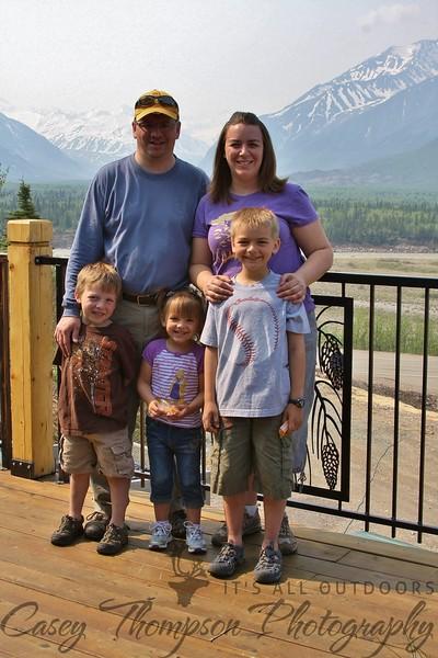 Thompsons on deck of Black Rapids Lodge