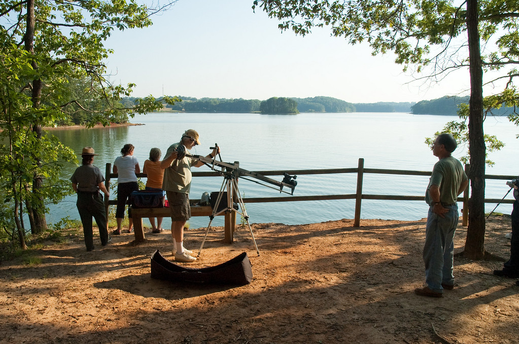 "Luther Lyle observing the filming of a scene for ""Experience Oconee"" at Lake Hartwell."