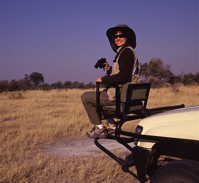 Janet sitting in the spotter's seat during a break on safari in Botswana.