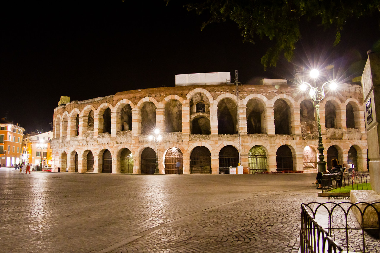 L'Arena di Verona, as seen from a park bench in Piazza Bra, Verona, Italy. Handheld, approximately 2100 hours.