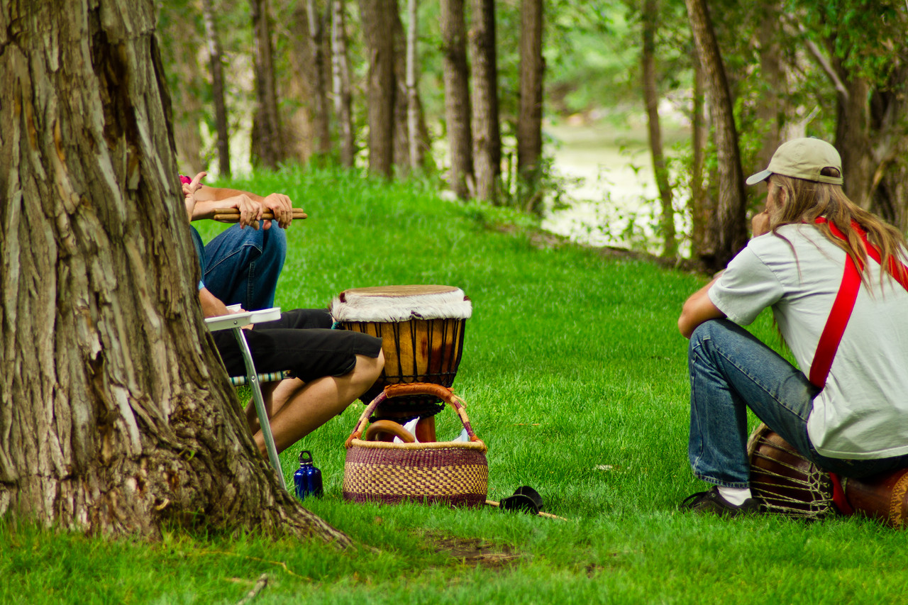the drum circle takes a few minutes of rest. The Arkansas river, famous for its kayaking, is in the background. Ahhh, the lazy days of summer.