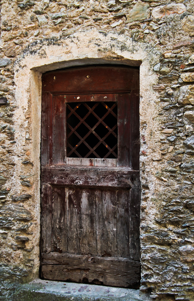 a typical door to a home in the village surrounding the base of the Castle at Castelvecchio Di Rocca Barbena, just a half hour drive from Toirano and the Ligurian Sea, nestled comfortably in the picturesque Neva Valley. The castle was built in the 12th century to protect against raids to the interior of the landholdings from Saracens. At one point the castle was given up due to a lack of water - the invaders simply waited it out.