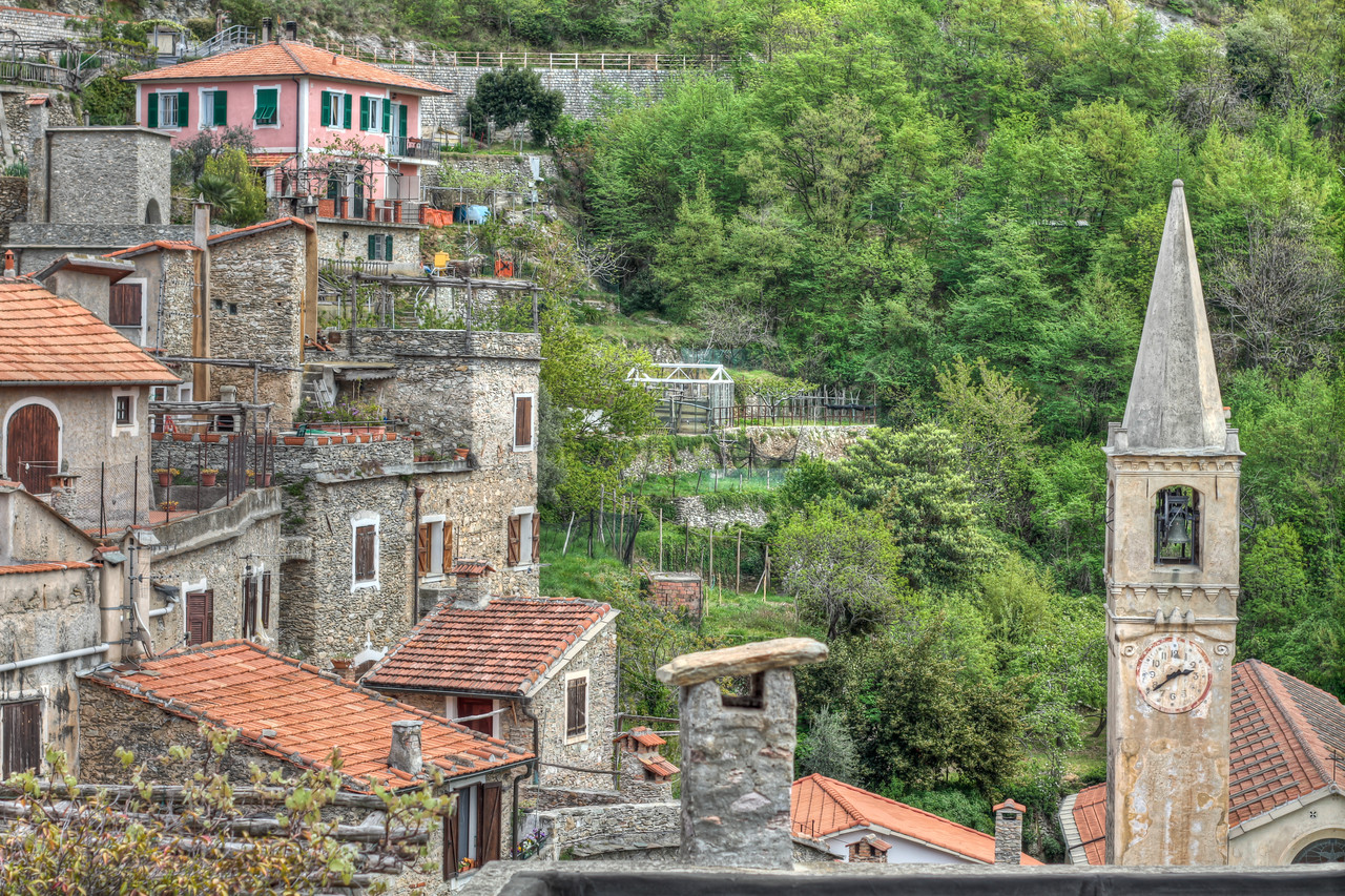 At the base of Castelvecchio Di Rocca Barbena in Liguria. These homes, most centuries old, line the narrow street (really not meant for anything more than a mule and cart) that leads to the top of the hill (camera left) and the old Castle.