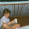 """""""Natalie writing in her journal @ maranatha 93""""<br /> I remember I had to lie in wait to get this photo she was particularly stuborn about not having her picture taken while we were at camp. Dispite the grainyness this is one of my fave photos of her ever :)"""