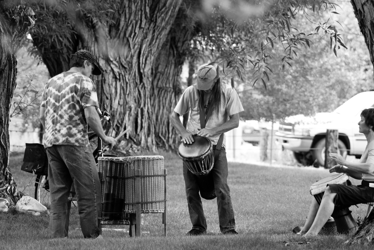I'm able to capture the peace and beauty of this drum circle in Salida, Colorado on a warm summer day. With the river to my left, the ancient trees surrounding us and the steady, peaceful  beat of the drummers, all I can think of at this moment is that we need more drum circles and fewer bombs.