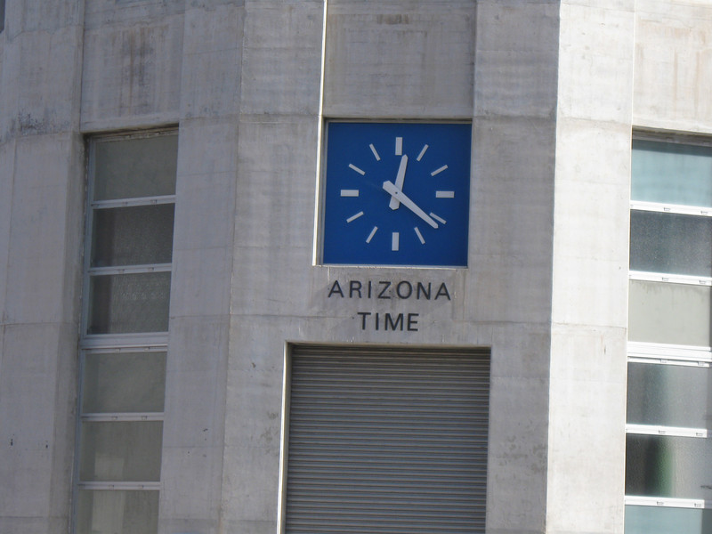 OVERFLOW TOWER     ARIZONA TIME 12:22PM AND THE NEVADA TIME IS 1:22PM IS ON THE OTHER TOWER CLOCK . MOUNTAIN AND PACIFIC TIME LINE RUNS DOWN THE MIDDLE OF LAKE MEAD AND COLORADO RIVER HERE.