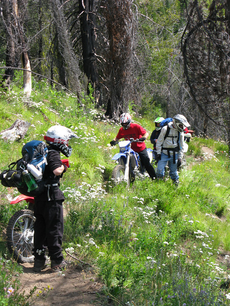 Equipment problems on narrow trail.