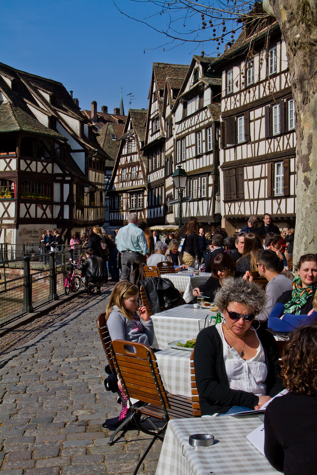 The weather in Alsace, France in March is really quite cold - rain and wind play a large role in that. But on this March day, the sun (if only for 3 hours) poked its head out of the grey clouds just in time for the lunchtime tables to fill completely in the town of Strasbourg.