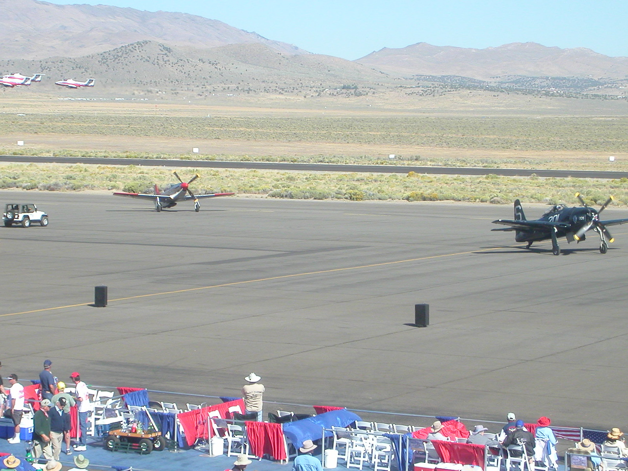 Look closely, jets flying too on the upper left corner. Corsair and Mustang. If you get a chance the Reno air show is a majestic display of aviation. The sounds are fantastic too.
