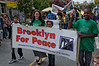 Marchers holding aloft the Brooklyn For Peace banner in the Flatbush Frolic parade.