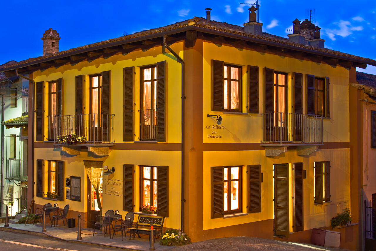 After taking some pictures at Castello di Grinzane Cavour as the sun was setting, I walked back to my car and happened upon this little Trattoria. The light from the fading sky, along with the nicely contrasting colors of the building and light inside the structure made for an interesting light combination.This is a 13 second exposure, so believe me, it was really quite dark out.