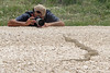 Danny taking a break to shoot a Coachwhip snake basking in the road, western Texas. Photo by K. Garten.