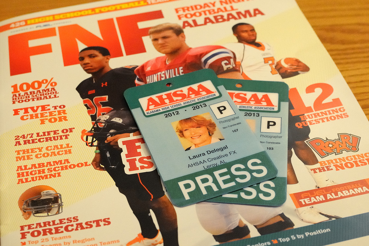 I'm doing the happy dance!!<br /> <br /> I received two wonderful gifts this week--my AHSAA pass for 2012-2013 and the 2012 FNF Alabama magazine.  The pass is my open door to all high school sporting events in the state of Alabama, including playoffs and championships.  It gets me on the sideline and in the press box (and gets Dave there too).  The magazine gives a preview of the upcoming Alabama high school football season and guess what, four of my photos were published in it this year!  One of my photos even made the table of contents page.  Yippee!  Of course, you have to look really hard under the photographer listing to see my tiny name--the only woman I might add--but it's there!  Dave gets excited about college football and I get excited about high school football.  These are little reminders of how blessed we are.
