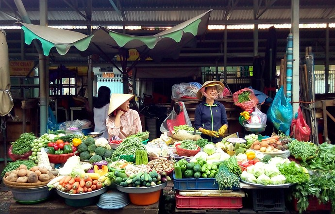 saigon street market stall vegetables