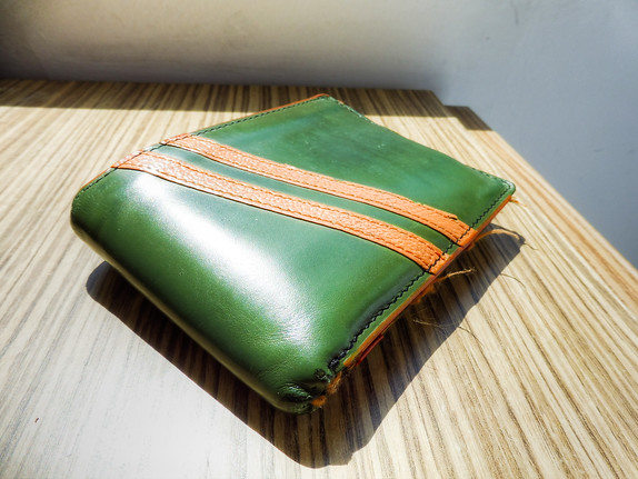 green and orange wallet