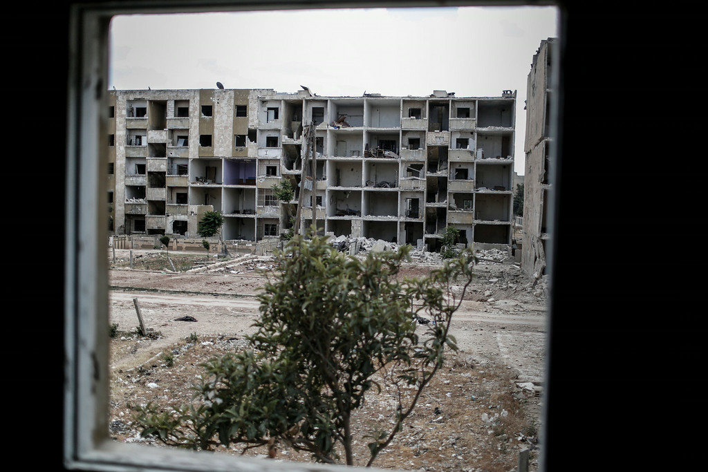 The view from an empty kitchen in an abandoned apartment in the Hanano neighbourhood of Aleppo on June 3, 2014. Hanano has been one of the districts worst affected by barrel bombs and other aerial assaults. <br /> [Sam Tarling for the Telegraph]