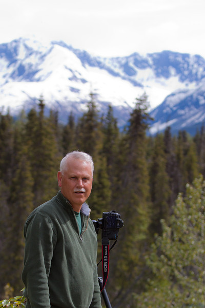 Gary Gee with mountain backdrop in the Kenai Peninsula, Alaska