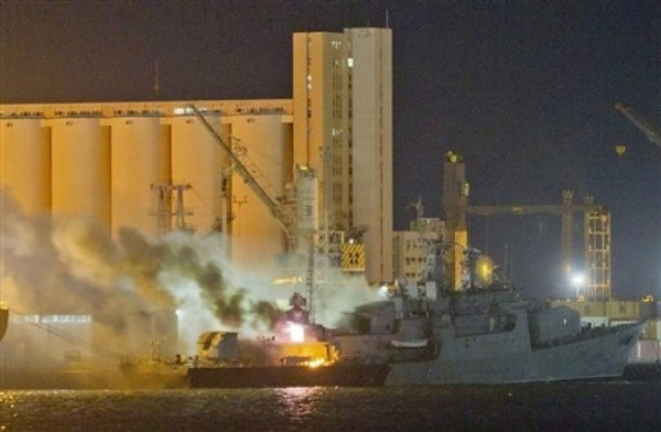 **ADDS INFORMATION IN SHIP & EXPANDS CAPTION**Smoke and flames pour from the Libyan Navy frigate Al Ghardabia, after it was hit during an airstrike by Tornado bombers of Britain's Royal Force on the port area of Tripoli, in the early hours of Friday May 20, 2011. NATO confirmed that its warplanes targeted the vessels and accused Libya of using its ships in the escalating conflict, including attempts to mine the harbor in Misrata. Rebels trying to end the nearly 40-year rule of Libyan leader Moammar Gadhafi have been struggling to hold the Western city of Misrata against repeated attacks by forces loyal to Gadhafi(AP Photo/Darko Bandic)