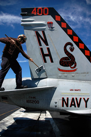 090819-N-1245S-006<br /> PACIFIC OCEAN (Aug. 19, 2009) Aviation MachinistÕs Mate 3rd Class Joshua Brock, assigned to the Sidewinders of Strike Fighter squadron of (VFA) 86, cleans an F/A18C Hornet aboard the aircraft carrier USS Nimitz (CVN 68).  Nimitz and embarked Carrier Air Wing (CVW) 11 are underway on a scheduled deployment to the western Pacific Ocean.  (U.S. Navy photo by Mass Communication Specialist 2nd Class Gregory A. Streit/Released)