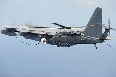 An MC-130P Combat Shadow from the 17th Special Operations Squadron refuels HH-60G Pave Hawks from the 33rd Rescue Squadron, both stationed at Kadena Air Base, Okinawa, as they fly to Osan Air Base Korea for PACIFIC THUNDER Oct. 27.<br /> <br /> PACIFIC THUNDER is an annual 10-day exercise that takes place Oct. 31- Nov. 9 at Osan Air Base, Korea involving the 33rd Rescue Squadron, Kadena Air Base, Japan, and the 25th Fighter Squadron, Osan Air Base, Korea. These units work together to practice Combat Search and Rescue tactics to prepare for real-world emergency situations. <br /> (U.S. Air Force photo/Tech. Sgt. Angelique Bilog)