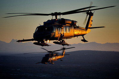 A pair of 210th Rescue Squadron HH-60 Pave Hawk helicopters fly over Alaska on a training mission. (Photo by Master Sgt. Sean Mitchell, 210th Rescue Squadron, Alaska Air National Guard)