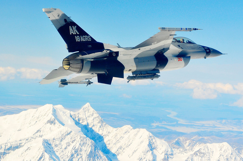 An F-16 Fighting Falcon from the 18th Aggressor Squadron at Eielson Air Force Base, Alaska, soars over the Alaska Range April 20, 2010, during RED FLAG-Alaska 10-2.  Aggressor pilots are trained to act as opposing forces in exercises like Red Flag to better prepare Air Force pilots for air combat.  (U.S. Air Force photo/Staff Sgt. Christopher Boitz)