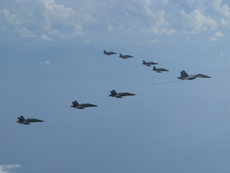 Tentera Udara Diraja Malaysia (Royal Malaysian Air Force) Su-30MKM carrying a Upaz 1a Sakhalin buddy refueling store in formation with F/A-18Ds and Hawk 208s