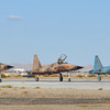 Participating in the semiannual Weapons and Tactics Instructor course, three F-5 Tiger II jets assigned to Marine Fighter Attack Training Squadron 401 line up prior to take off from the flight line of the Marine Corps Air Station in Yuma, Ariz., on Oct. 16, 2010. As the Marine Corps' only squadron to fly the F-5 jets, the pilots of VMFT-401 portray enemy aircraft for pilots training in Yuma. WTI, hosted by Marine Aviation Weapons and Tactics Squadron 1, trains Marine students from across the globe to return to their units as training officers versed in the latest aviation tactics and procedures. (Photo by Gunnery Sgt. Bill Lisbon)