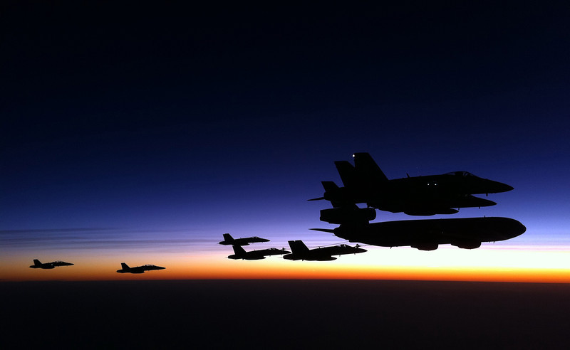 """""""Soaring High"""" As the Fighter Combat Instructor Course conducts air to air refueling during Exercise Aces North 2011.<br /> <br /> Mid caption: Australia's elite fighter pilots are battling it out in the skies over the Top End for Exercise Aces North as part of No. 31 Fighter Combat Instructor course. Aces North represents the culmination of the challenging 'top gun' course, which sees advanced fighter combat tactics and scenarios played out during the three-week exercise between 30 May until 23 June.<br /> <br /> The post-graduate course is conducted every two years and provides experienced F/A-18 Hornet Pilots with extensive training in all air combat related roles.<br /> <br /> For the first time Aces North will bear witness to the integration of new air battle management capabilities provided by the Wedgetail Airborne Early Warning and Control aircraft and take advantage of the F/A-18F Super Hornet's air superiority. The integration of these new platforms provides Air Force with a greatly enhanced network centric war fighting capability.<br /> <br /> The Fighter Combat Controller and Fighter Intelligence Instructor courses run parallel to the Fighter Combat Instructor course, combining elite tactics development from a wide spectrum of capabilities. The Fighter Combat Controllers are presented with challenging scenarios that aim to test the aircrews' understanding and execution of fighter tactics, and the ability of the Air Battle Managers to deliver those tactics.<br /> <br /> Fighter Combat Instructors form an elite fraternity of the most advanced and experienced fighter pilots. The Fighter Combat Instructor's role is to provide leadership in the development of fighter tactics and determine how those tactics can be used to enhance the Australian Defence Force's joint war fighting capability.<br /> <br /> The Fighter Combat courses put members through some of the most challenging and intensive situations to ensure we can produce our next generation of elite tact"""