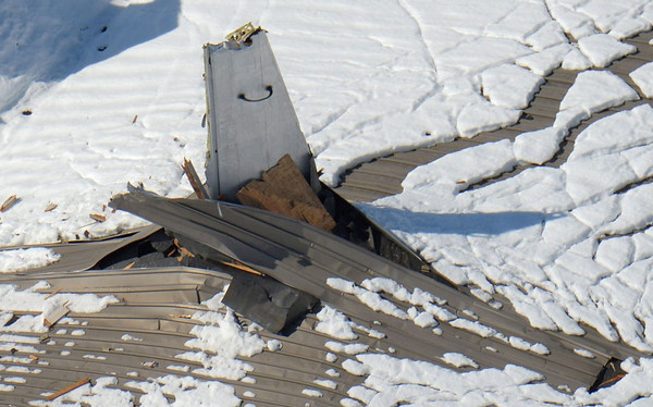 http://www.thebaseleg.com/Other/My-SmugMug-Site-Files-Do-Not/i-jfdKLhL/0/M/jmsdf_usn_p3_orion_hangar_damage-M.jpg