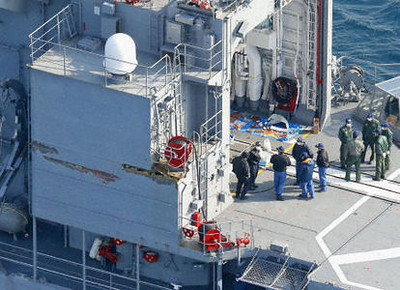 SAPPORO, Japan - Photo taken from a Kyodo News helicopter on April 15, 2012, shows the Maritime Self-Defense Force destroyer Matsuyuki in Mutsu Bay in Aomori Prefecture. An MSDF patrol helicopter with seven crew members aboard crashed into the bay the same day after hitting the destroyer. Damage believed to have been caused by the helicopter hitting the vessel is seen around the hangar on the port side (C left). (Kyodo)