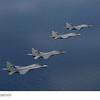 MiG-29s of the Tentara Udara Diraja Malaysia (Royal Malaysian Air Force) fly in formation over the South China Sea at Exercise Bersama Shield 2011. (Photo Credit: Commonwealth of Australia; Royal Australian Air Force Photo)