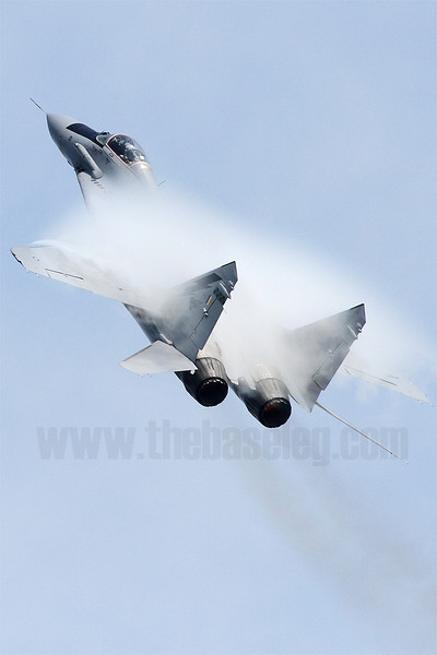 Singapore's humid air provides great condensation effects as this Royal Malaysian Air Force MiG-29N Fulcrum pulls Gs during it's its solo performance as part of the RMAF's Smokey Bandits display team. Singapore Airshow 2012