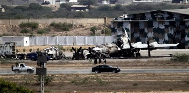 Wreckage of a Pakistan Navy aircratfs is seen Karachi, Pakistan on Monday, May 23, 2011. Pakistani commandos were close to regaining control of a naval base Monday as they hunted for any last holdouts among a team of Islamist militants who attacked and occupied the facility for 15 hours, destroying two U.S.-supplied planes and killing 12 security officers. (AP Photo/Shakil Adil)