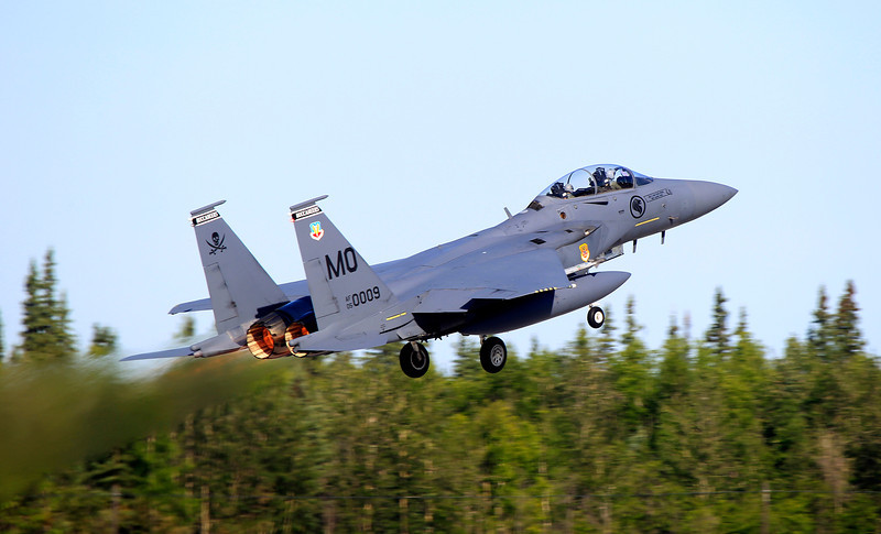 A Republic of Singapore Air force F-15SG, based out of Shaw Air Base Idaho, roars into the air on the first mission for Exercise Red Flag Alaska 11-2.<br /> <br /> Seven F/A-18 Hornets from RAAF Williamtown's No 3 Squadron in NSW are participating in world-class air combat training in the skies above Alaska from 11 until 22 July. The fighter jets will operate from Eielson Air Force Base, Alaska, to participate in the most advanced international air combat training activity, Exercise Red Flag.<br /> <br /> Red Flag is a United States Pacific Air Forces Command led large force employment exercise designed to replicate a high-end combat environment. This is one of the largest exercises Australia will participate in this year. It provides the ultimate environment in which our Air Force personnel can showcase their extraordinary abilities in a deployed scenario. Regular participation in the Red Flag exercise series is a major contributor to Australia's high standard of air combat capability.<br /> <br /> Aircrew will be exposed to large force employment on a scale not possible in Australia, when they perform counter air, precision strike and offensive air support in packages of up to 100 aircraft. The exercise also provides invaluable training for logistics, support and maintenance personnel as they are able to practice deploying to another country and working together with other Air Forces. The coalition exercise will involve participants from Australia, Japan, the Philippines, Singapore, Thailand and the United States.<br /> <br /> Red Flag Alaska is a large-forces exercise conducted in interior Alaska to simulate air combat. Aircrews will be operating in the 67,000 square-mile Joint Alaska Pacific Range Complex, which offers adequate space and ranges for crews to simulate full-scale aerial battles. Australia last participated in Red Flag Alaska in 2008 and has participated in the exercise series since 1980.