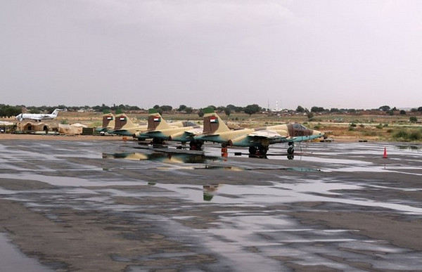"Four Russian Sukhoi Su-25 ""Frogfoot"" ground-attack jets sit on the tarmac of El Fasher airport in North Darfur, in this photograph taken October 8, 2010. Sudan has acquired 15 Russian-made Sukhoi Su-25 ""Frogfoot"" jets from Belarus since 2008, and there is controversy over whether the Sudanese government has used them for air attacks against Darfuris in defiance of the 2005 U.N. arms embargo, according to UN report on arms embargo breaches on October 22, 2010. Picture taken October 8, 2010. REUTERS/Louis Charbonneau  (SUDAN - Tags: TRANSPORT MILITARY POLITICS)"