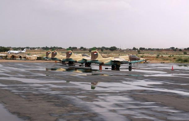 """Four Russian Sukhoi Su-25 """"Frogfoot"""" ground-attack jets sit on the tarmac of El Fasher airport in North Darfur, in this photograph taken October 8, 2010. Sudan has acquired 15 Russian-made Sukhoi Su-25 """"Frogfoot"""" jets from Belarus since 2008, and there is controversy over whether the Sudanese government has used them for air attacks against Darfuris in defiance of the 2005 U.N. arms embargo, according to UN report on arms embargo breaches on October 22, 2010. Picture taken October 8, 2010. REUTERS/Louis Charbonneau  (SUDAN - Tags: TRANSPORT MILITARY POLITICS)"""