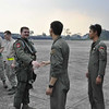 U.S. Air Force Capt.  Robert Hilby, 13th Figther Squadron pilot, is greeted by Royal Singapore air force Lt. Col. Adrian Toh, 143rd Fighter Squadron commander, upon his arrival to Paya Lebar Air Base, Singapore, March 2012. Members of the 13 FS are currently fixing and flying aircraft alongside their RSAF counterparts for three weeks during Commando Sling. (Courtesy Photo)