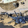 Japanese military helicopter sits among debris at Matsushima air base of the Japan Air Self-Defense Force, northeastern Japan, on Saturday, March 12, 2011, one day after a giant quake and tsunami struck the country's northeastern coast. (AP Photo/Kyodo News)  MANDATORY CREDIT, NO LICENSING ALLOWED IN CHINA, HONG  KONG, JAPAN, SOUTH KOREA AND FRANCE