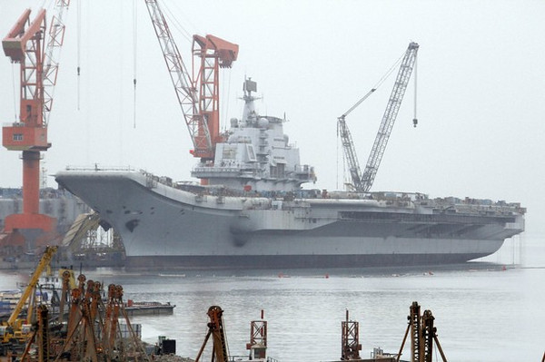 "A vessel reported to be the Ukrainian-made aircraft carrier ""Varyag"", which China bought in the 1990s, is seen at a port in Dalian, Liaoning province, in this April 17, 2011 file photo. China's first aircraft carrier, a retrofitted ship bought from Ukraine in 1998, is expected to be mainly used for training purposes and could begin sea trials within a few weeks, a state-run newspaper reported on July 12, 2011. Picture taken April 17, 2011.    REUTERS/Stringer/Files (CHINA - Tags: MILITARY) CHINA OUT. NO COMMERCIAL OR EDITORIAL SALES IN CHINA"