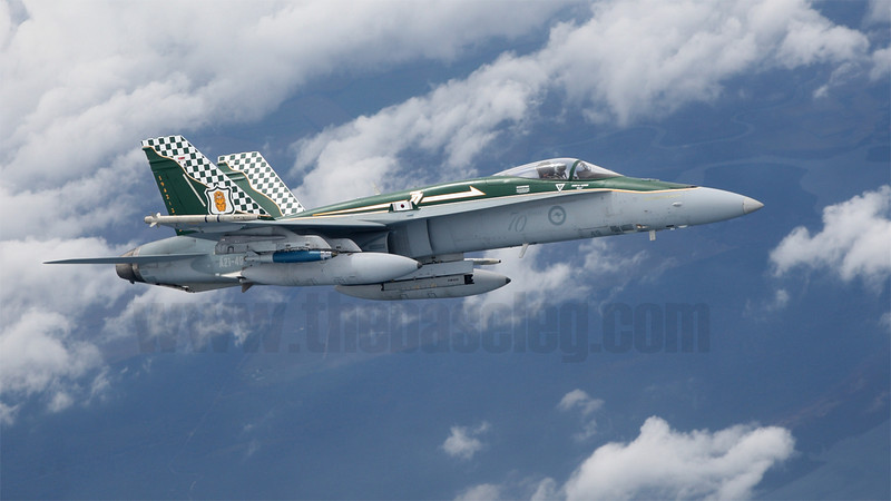Royal Australian Air Force F/A-18A Hornet A21-49 in 77 Sqn 70th Anniversary scheme formates on its tanker off Gippsland in Victoria