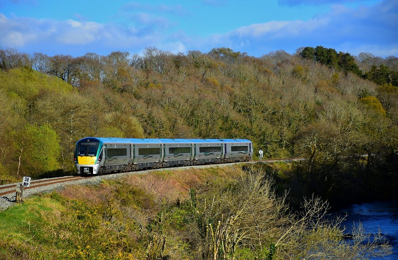 22036 passes Yellow Quarry crossing outside Killarney with the 1750 Tralee - Heuston. Sun 11.04.21