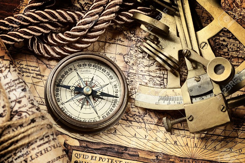 18232873-vintage-still-life-with-compass-sextant-and-old-map-Stock-Photo