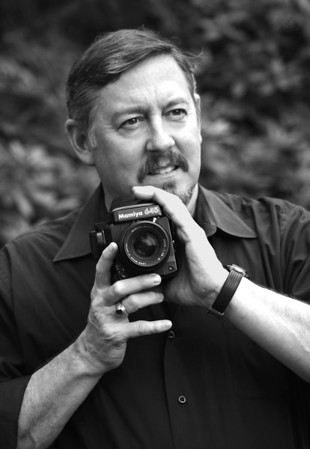 """</div>      <div style=""""clear: both;""""></div>  <div class=""""myText""""> <p>David A. Tucker II has been creating photographs since 1980 and began focusing on the nude in 1987. His photographic series, <i>The Human Landscape</i>, explores the human figure in studio and natural environments. In 1995 he began work on the photographic series, <i>Danceworks</i>, collaborating with ballet and modern dancers to capture the transitory beauty of movement. He continues to explore and add new images to each photographic series of work.<p> <p> The photographic series, <i>DEPLOYED: Haiti, Kosovo, Iraq</i> were taken from 1994 - 2004 while a member of the U.S. Army. <p> Tucker has exhibited and sold his photographs at a number of galleries throughout the nation, including the DeMatteis Gallery (Annapolis, MD), Silver Image Gallery (Seattle, WA), PhotoZone Gallery (Eugene, OR), The Photo Factory Gallery and Lumina Gallery (San Diego, CA), and Photography West Gallery (Carmel, CA). His works may be found in several private collections.<p>  <p> As both a fine art and journalism photographer, his images have been published in numerous publications including <i>Black & White Magazine</i>, <i>The San Diego Union-Tribune</i>, <i>The Los Angeles Times</i>, <i>The Orange County Register</i>, <i>The Seattle Times</i>, <i>American Theatre Magazine</i>,<i> Dramatics Magazine</i>, <i>InTheatre Magazine</i>, and the book, """"Theater in America.""""</p> <p>  <p>All of his images are captured on black and white film, hand-printed on fiber-based paper and then digitally scanned for reproduction. The photographs available here are printed on archival digital paper and signed on the back by the artist.</p> <p> <p> <p> <b>For inquiries or to purchase prints, please contact:</b> <p> <p> Mariane Lenhardt <p> M.I.A. Gallery <p> Seattle, WA <p> info@m-i-a-gallery.com <p> (206) 467-4927 <p> </div>      <div style=""""clear: both;""""></div>"""