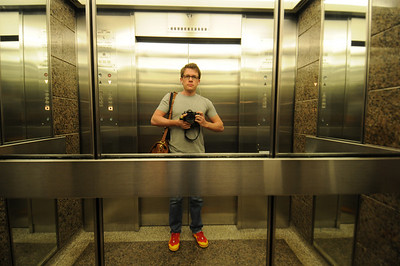 Elevator.  They're super fast.  But not as fast as Kyle's in Sydney.