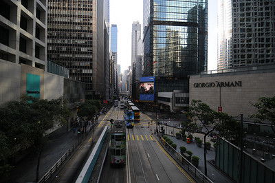 Looking out at Des Veoux Road in Central from the Sky Bridge.  Notice the trams, referred to as the Ding Ding by locals.
