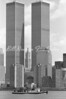 """The Trade Towers with the New York FD fireboat """"JOHN J. HARVEY"""" passing in front...on the day the towers went down the """"HARVEY"""" operated for several days even though she was privately owned. ...."""